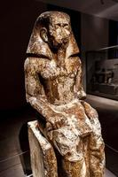TURIN, ITALY, JUNE 3, 2015 - Statue of governor Wakha, son of Neferhotep in Museo Egizio in Turin, Italy. Museum houses one of largest collections of Egyptian antiquities more than 30,000 artefacts. photo