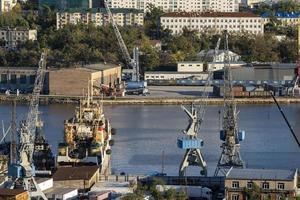 Vladivostok, Russia - October 11, 2021- Seascape with a view of the Diomid fishing port photo