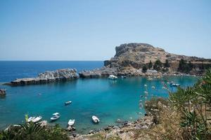 Beautiful bay close to Lindos, Rhodes, Greece. Many boats, blue water and sunny day photo