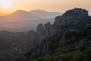 Landscape of Meteora Mountains, Greece at sunset photo