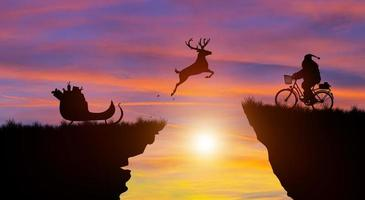 Welcome merry Christmas and Happy new year with Silhouette Santa Claus. photo