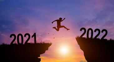Welcome merry Christmas and Happy new year in 2022 with Man jumping. photo