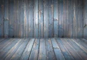 Blue painted wood table with dark wall background photo
