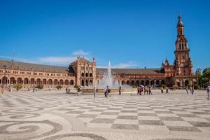 Seville Spain, 2017 - Tourists walking around the famous ancient landmark Plaza de Espana. photo