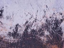 Frayed and scratched sheet metal texture background. photo
