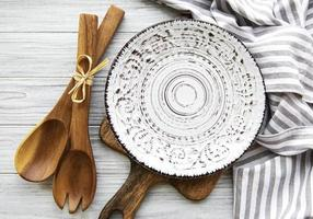 Empty plate on a wooden table photo