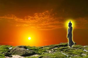 Buddha looking seven day style on the sunset sky photo