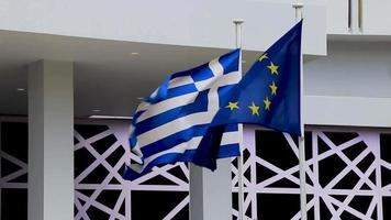 Greek blue white flag and europe EU flag Rhodes Greece. video
