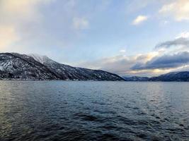 Winter landscape fjord sunrise sunset, Norway. Ferry Vangsnes to Balestrand. photo