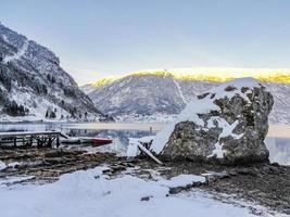 Winter landscape at the frozen fjord lake river Framfjorden, Norway. photo
