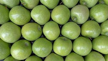 Close up granny smith apple in market stall photo