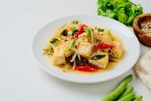 Indonesian stir fry bean sprouts mixed with fried tofu photo
