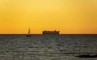A transport ship at sunset photo