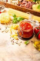 Glass jar with homemade classic spicy tomato pasta or pizza sauce. photo
