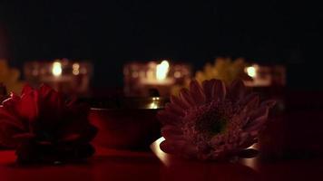 Diwali Indian holiday. Woman lights a diya oil lamp during celebration. video