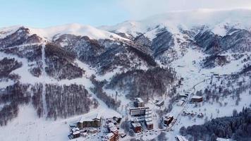 Snowy ski resort at the sunset video