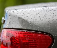 Drops of water a black car photo