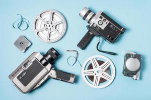 overhead view film strips film reel various type camcorder blue background photo