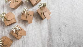 overhead view many gift cardboard boxes wooden textured backdrop photo