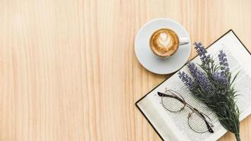 overhead view coffee latte lavender flower spectacles notebook wooden background photo