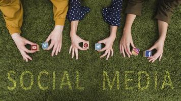 overhead view female s hand holding social network app symbol blocks lawn photo