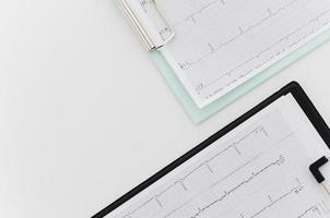 overhead view ecg medical report blue black clipboard white background photo