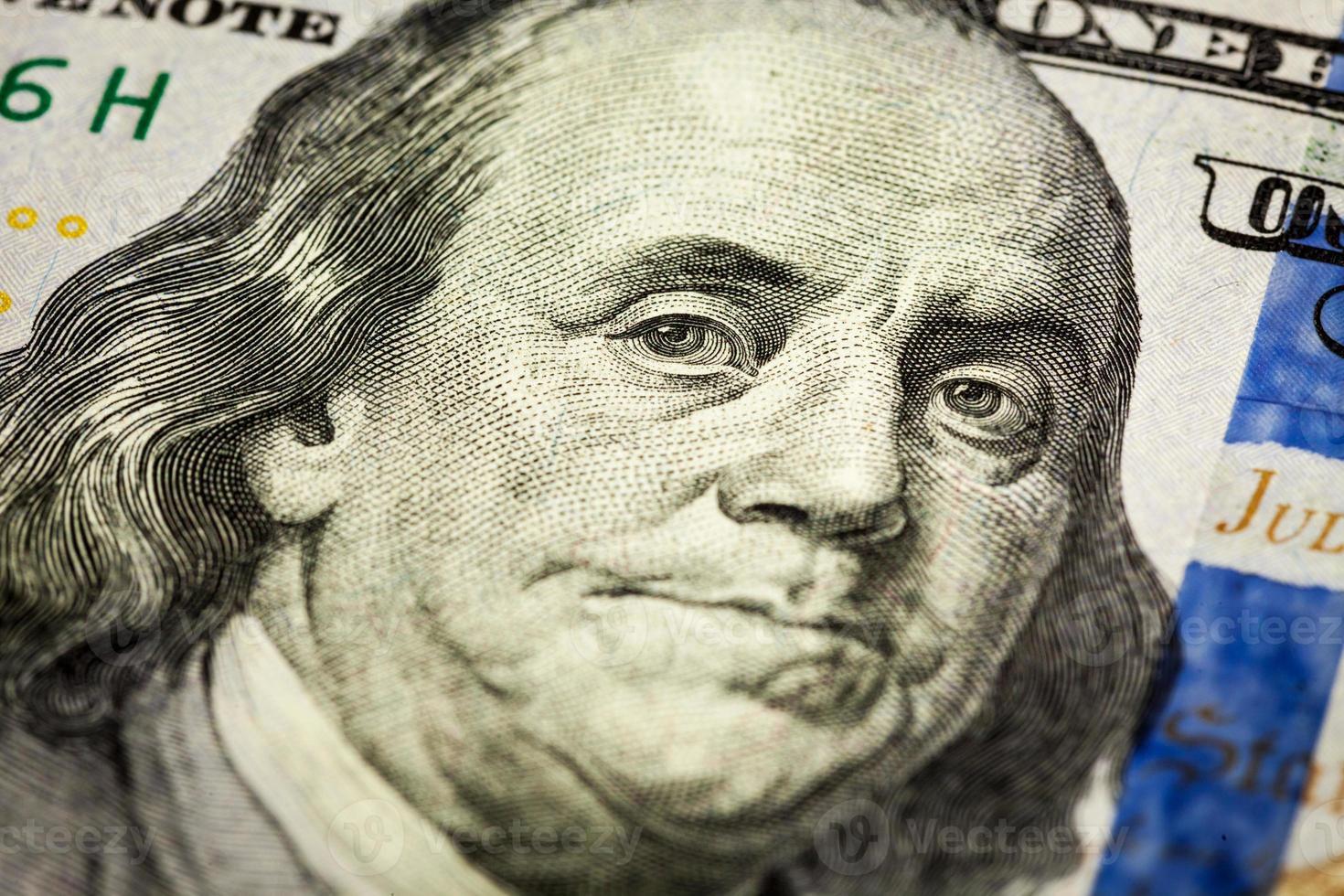 colpo di macro del ritratto di Benjamin Franklin della fattura 100 foto