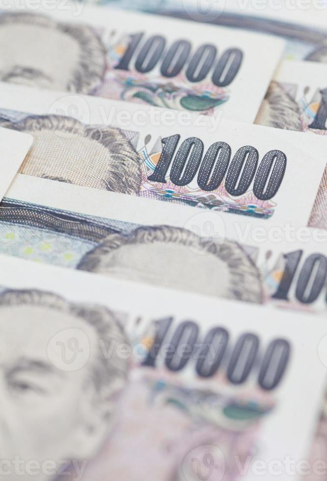 pila di valuta giapponese yen o banconote giapponesi foto