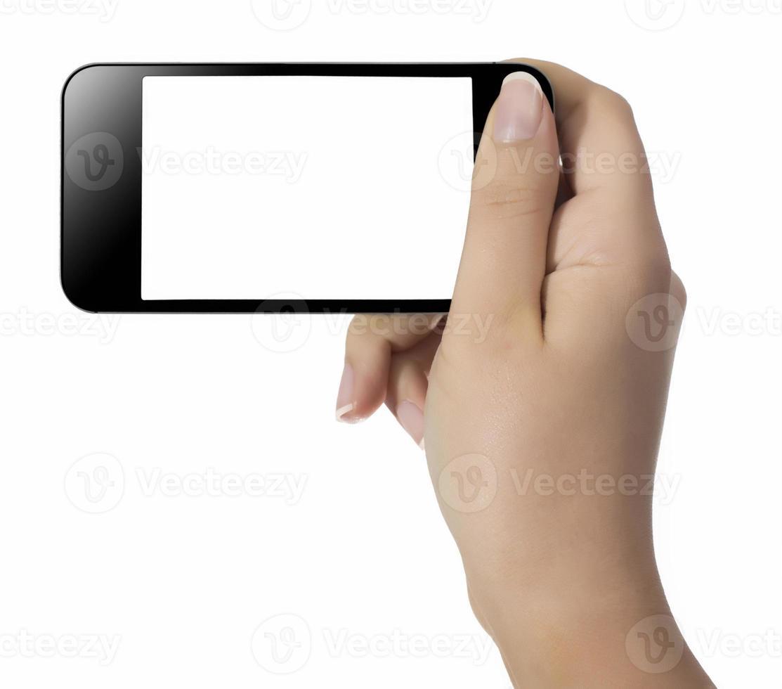 mano che tiene il telefono cellulare foto