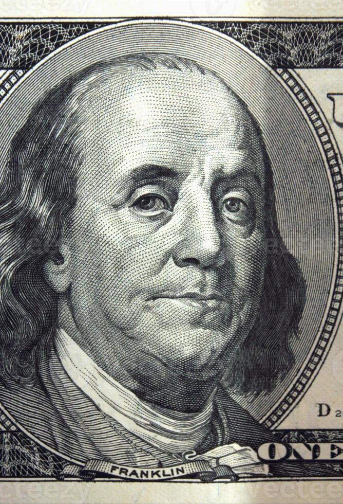 Chiuda in su della banconota in dollari foto