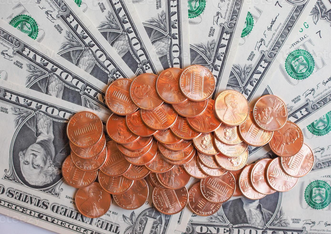 monete e banconote da un dollaro foto