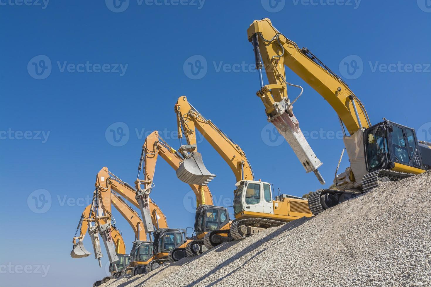 spettacolare gruppo di escavatori foto