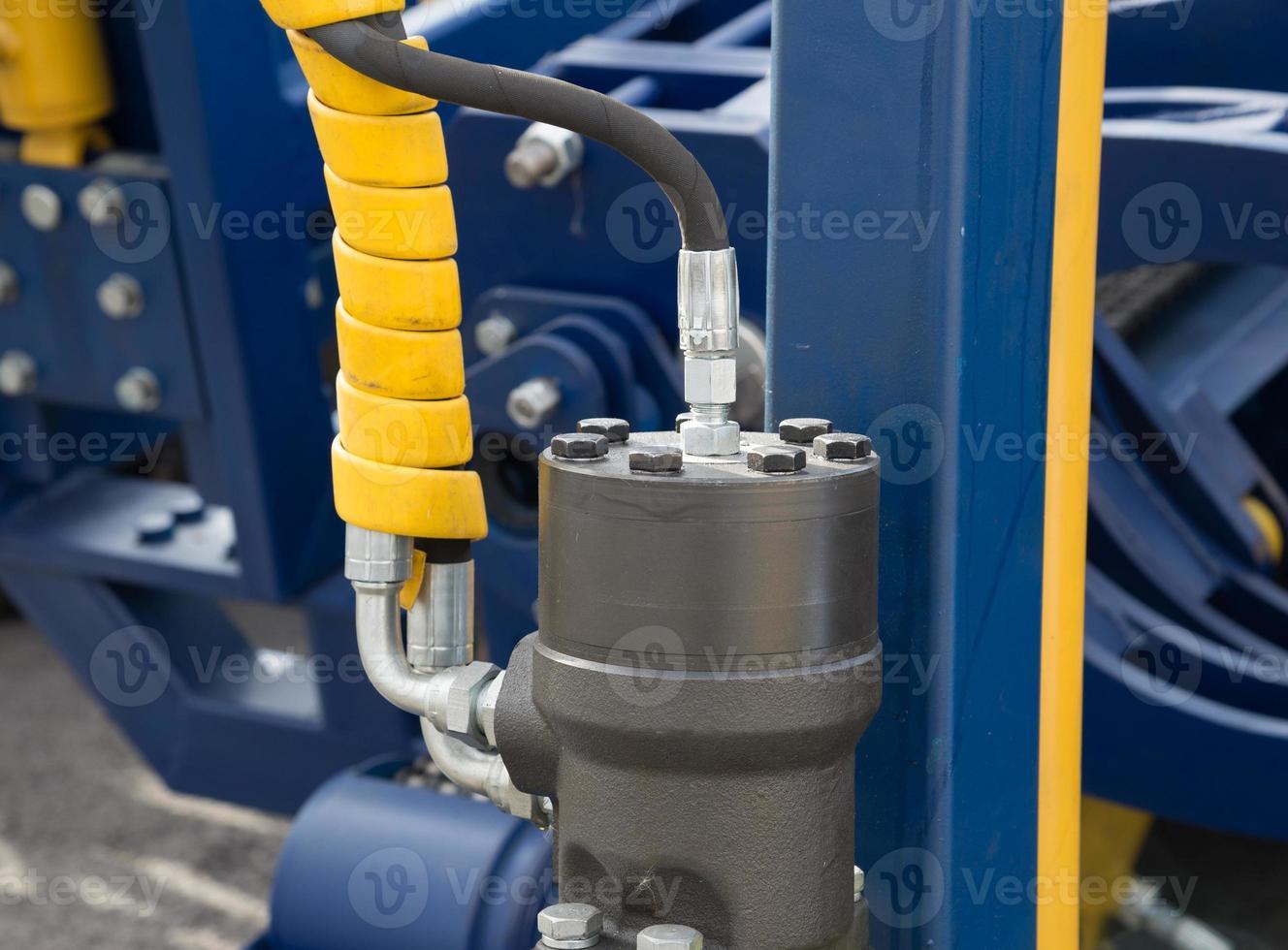 braccio idraulico dell'escavatore del pistone del bulldozer foto