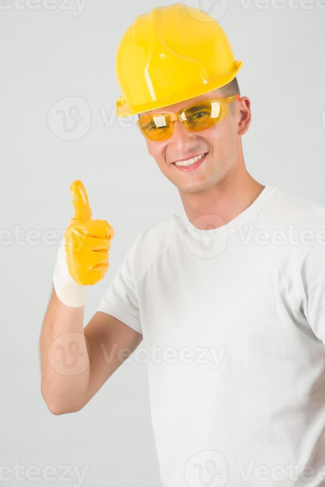 giovane architetto con pollice in alto gesto foto