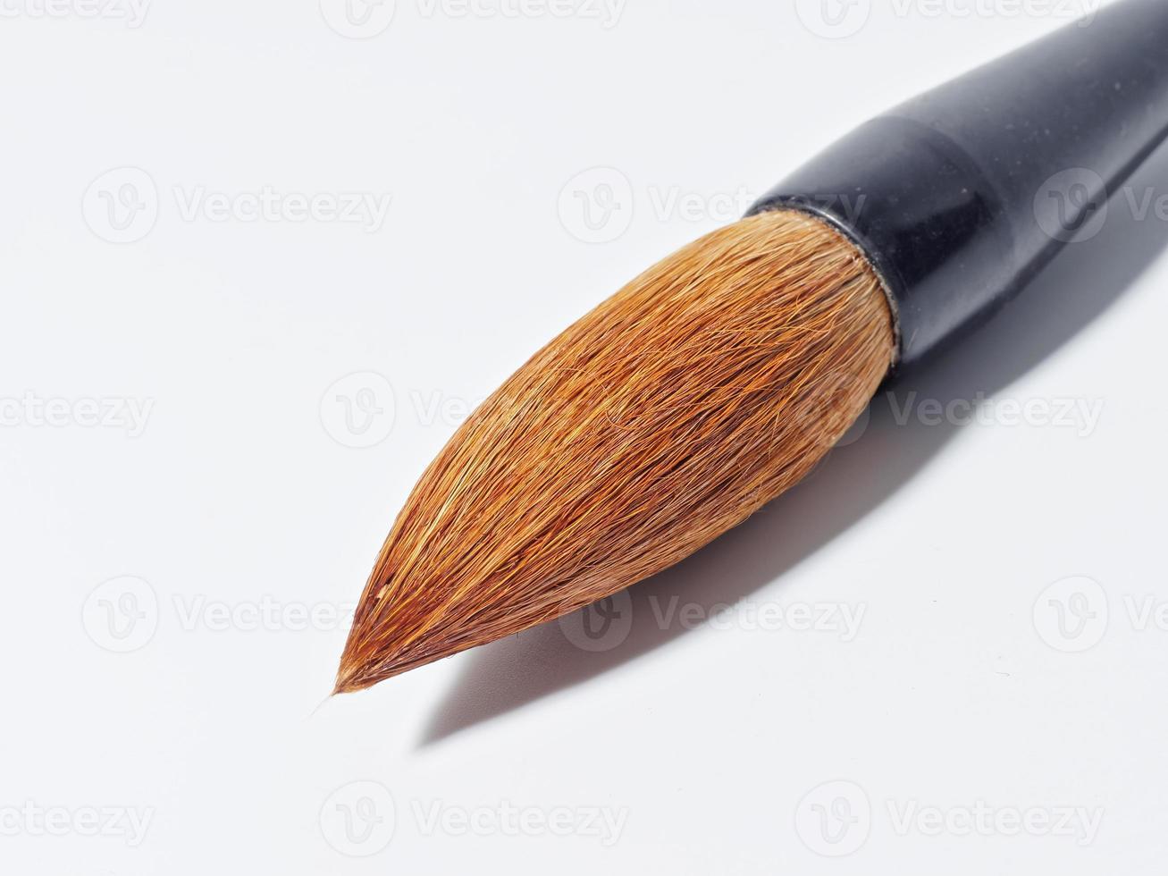 spazzola di scrittura cinese su fondo bianco foto