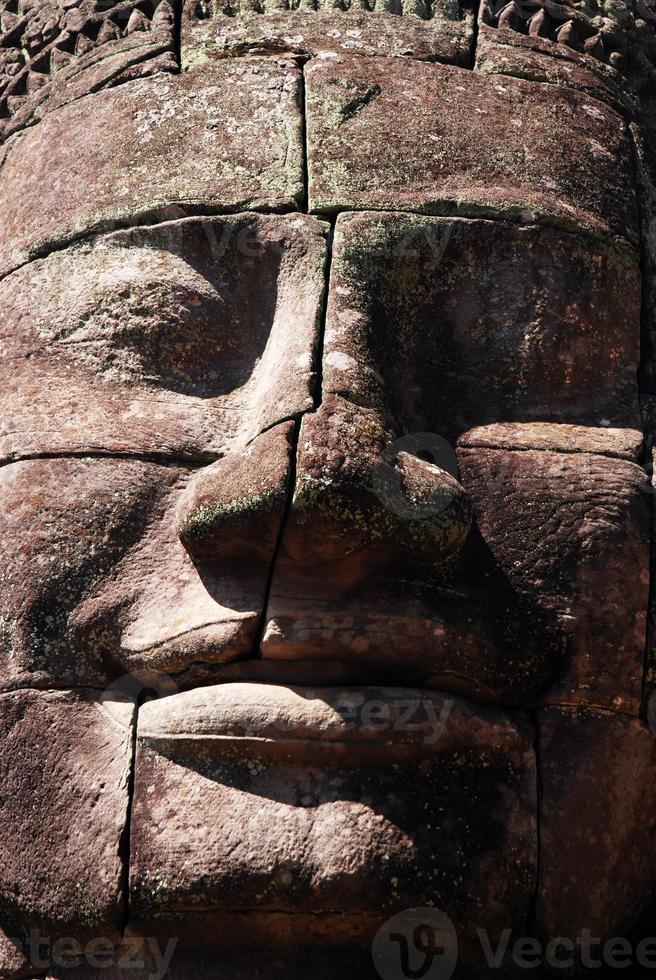 enorme faccia al tempio di bayon, angkor, cambogia foto