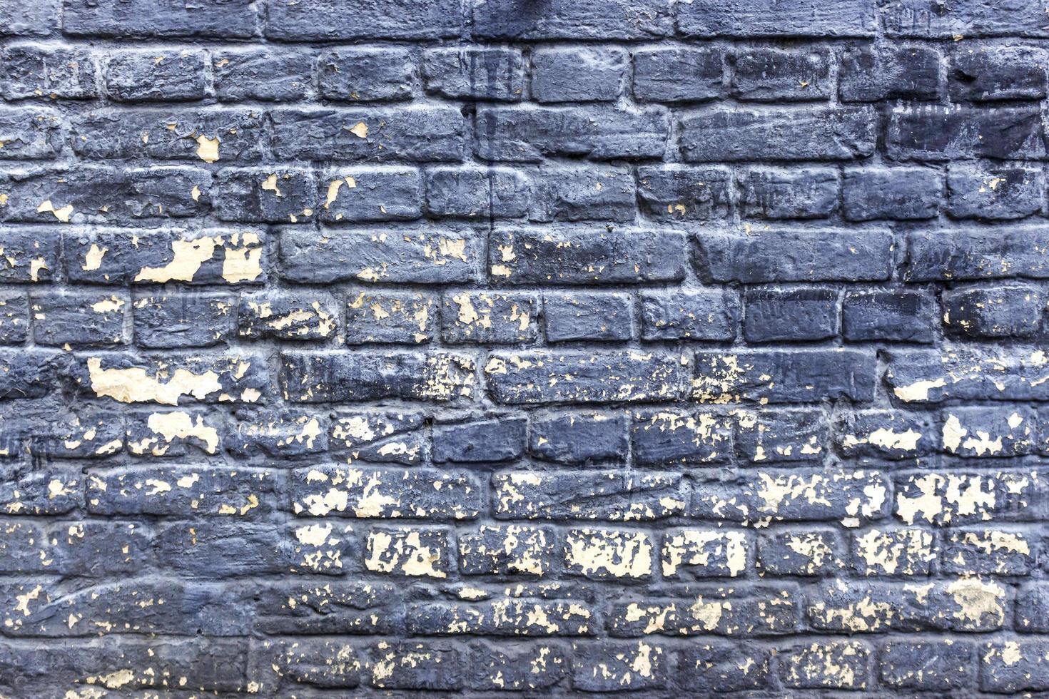 vecchie trame di muro di mattoni incrinati foto