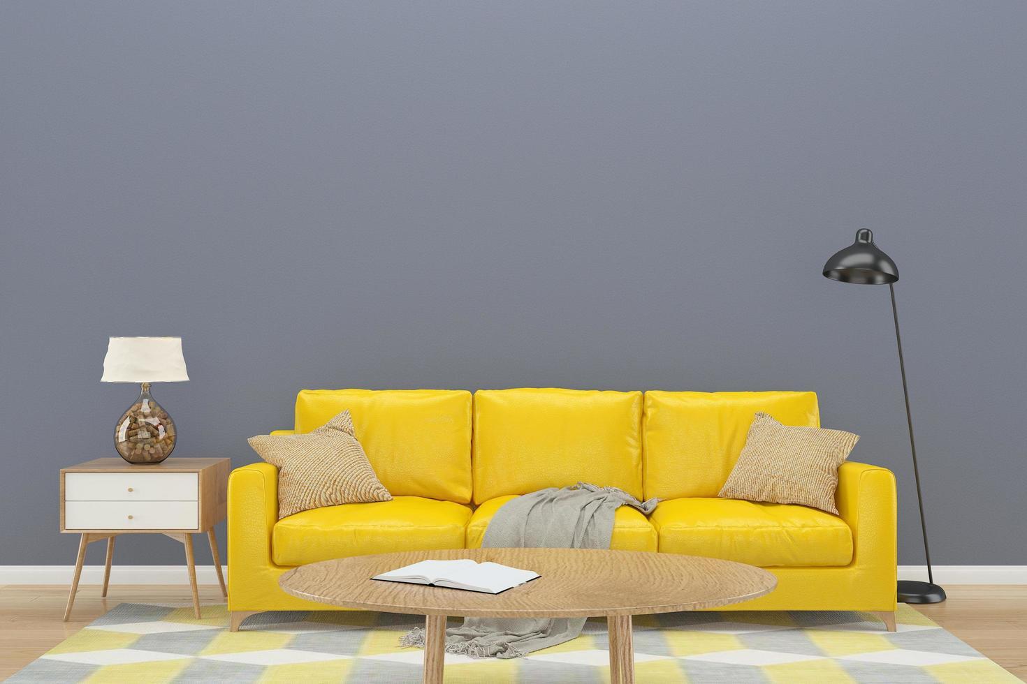 muro grigio con divano giallo sul pavimento di legno foto
