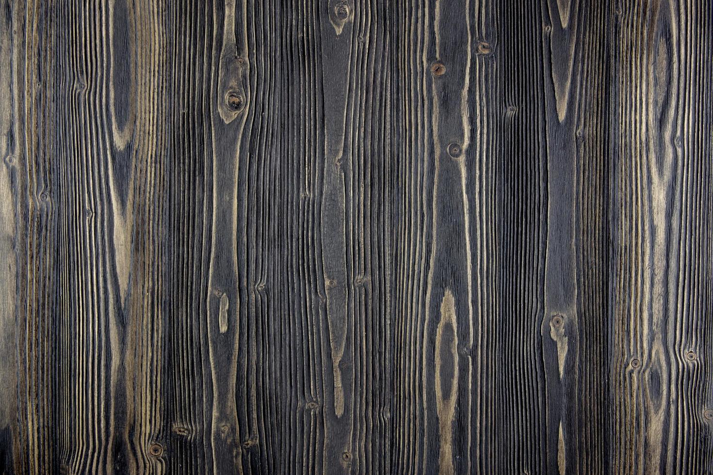 superficie del tavolo in legno scuro foto