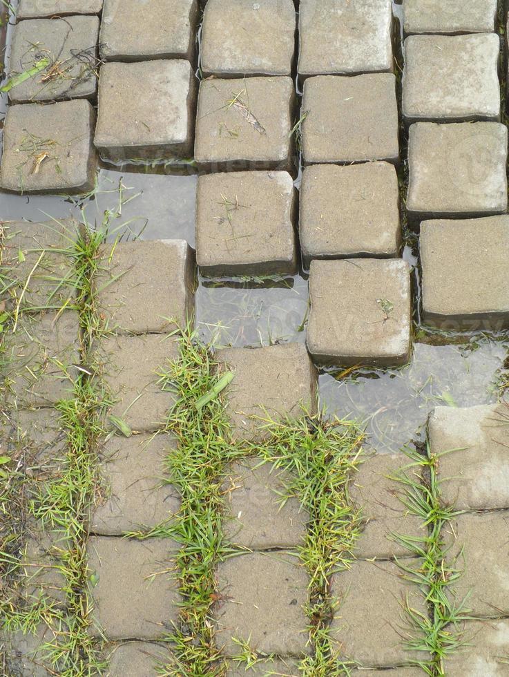 superficie di una pavimentazione in mattoni di cemento rotto per lo sfondo strutturale foto