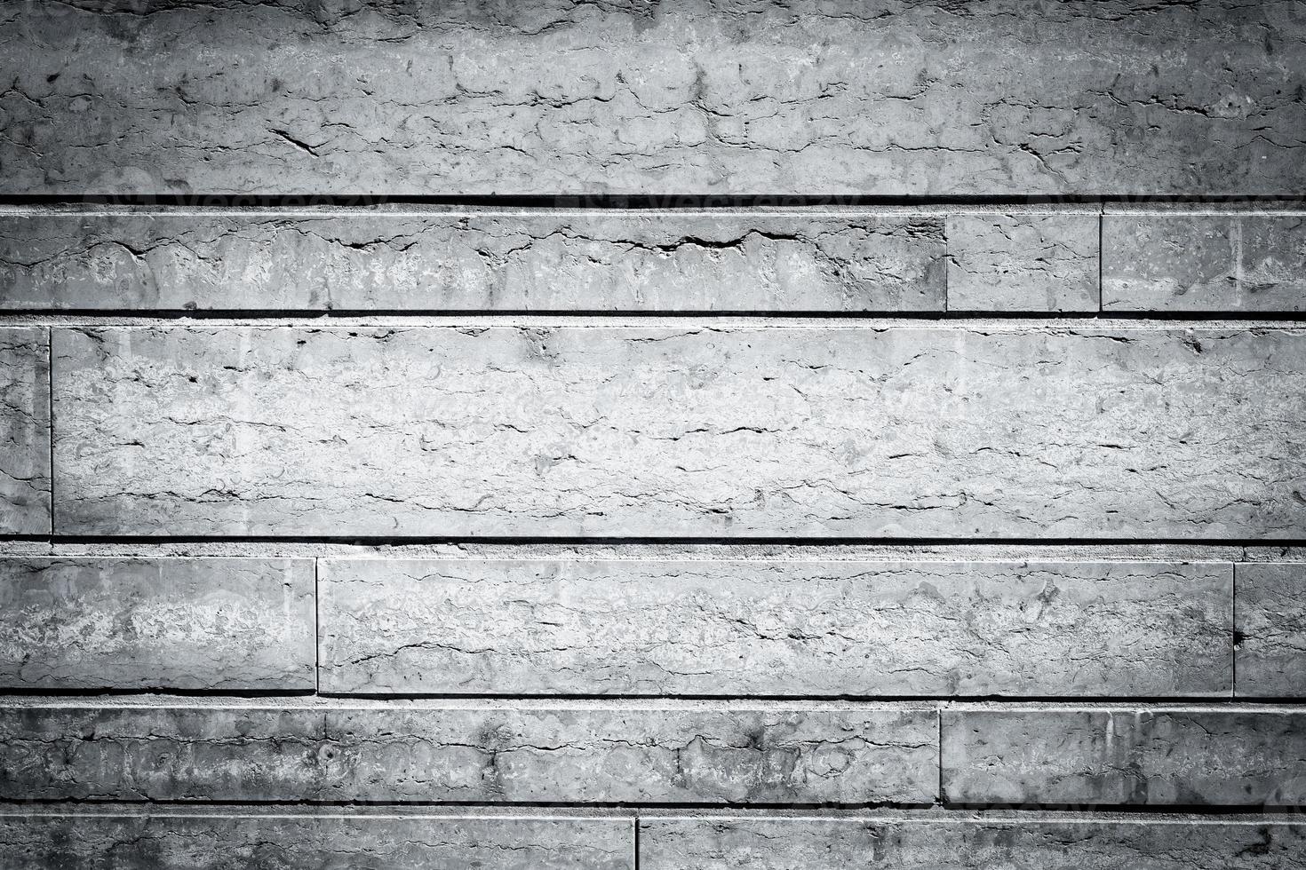 struttura del muro di pietra grigia foto