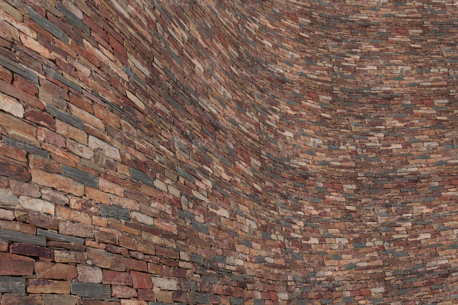 muro di mattoni di pietra foto