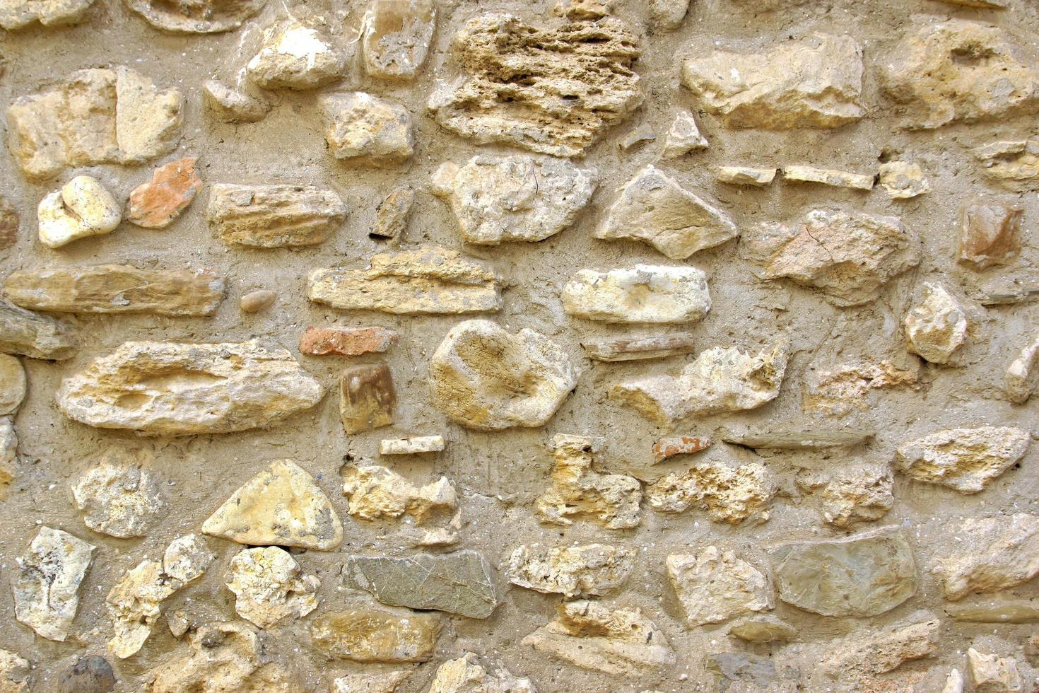 sfondo decorativo vecchio muro di pietra foto