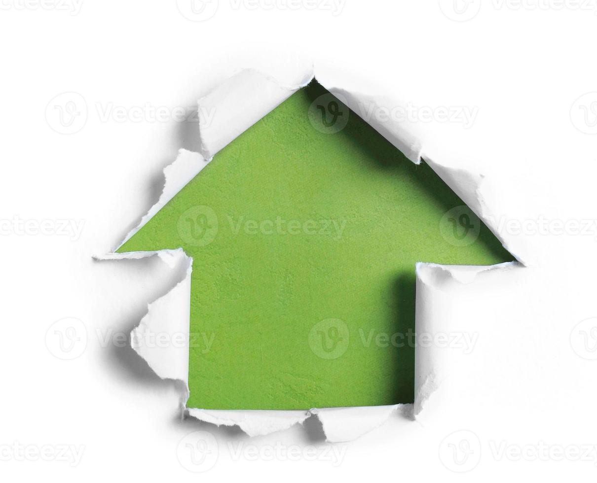 carta strappata bianca a forma di freccia foto