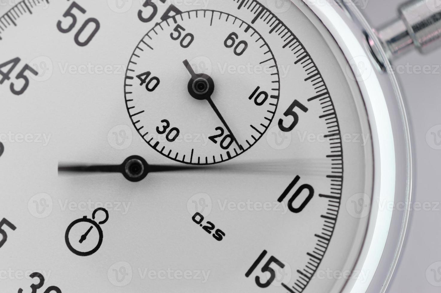 primo piano del cronometro. con una freccia in movimento foto