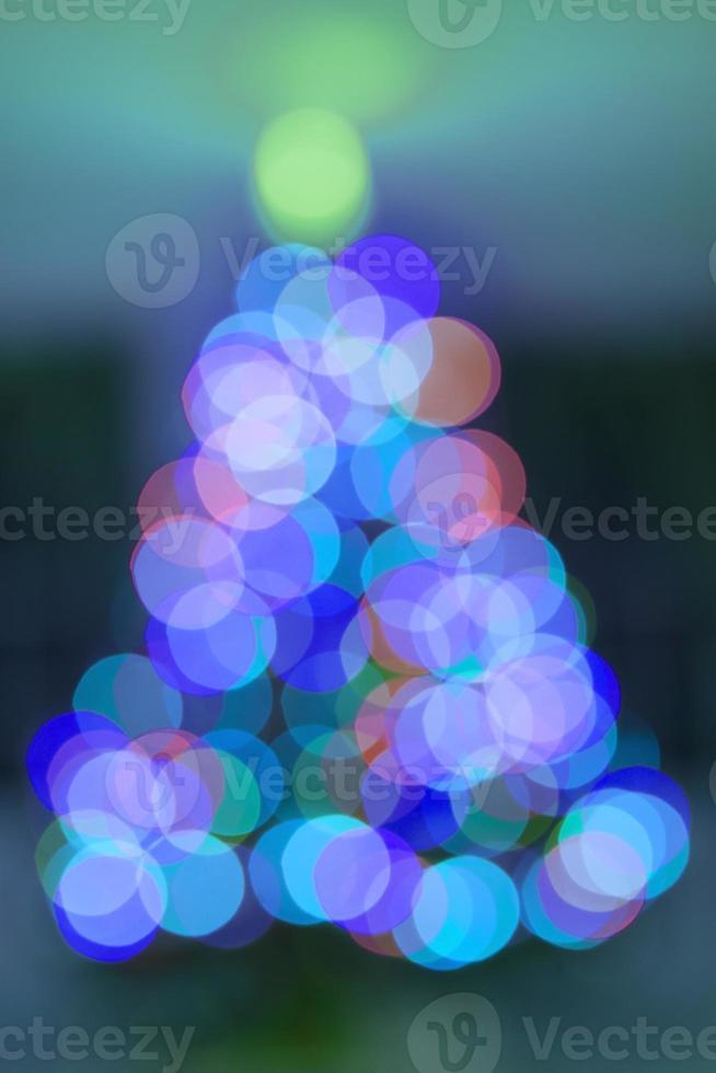 bokeh luce astratta dell'albero di Natale sopra per lo sfondo foto