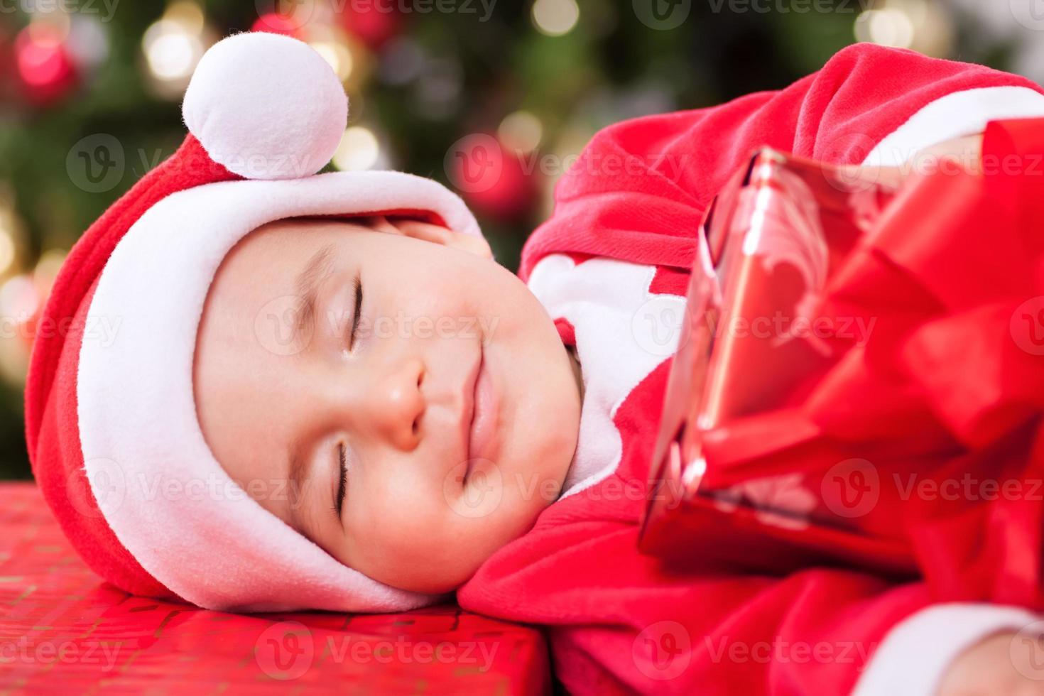 sorridente bambino bambino Babbo Natale con bei sogni foto