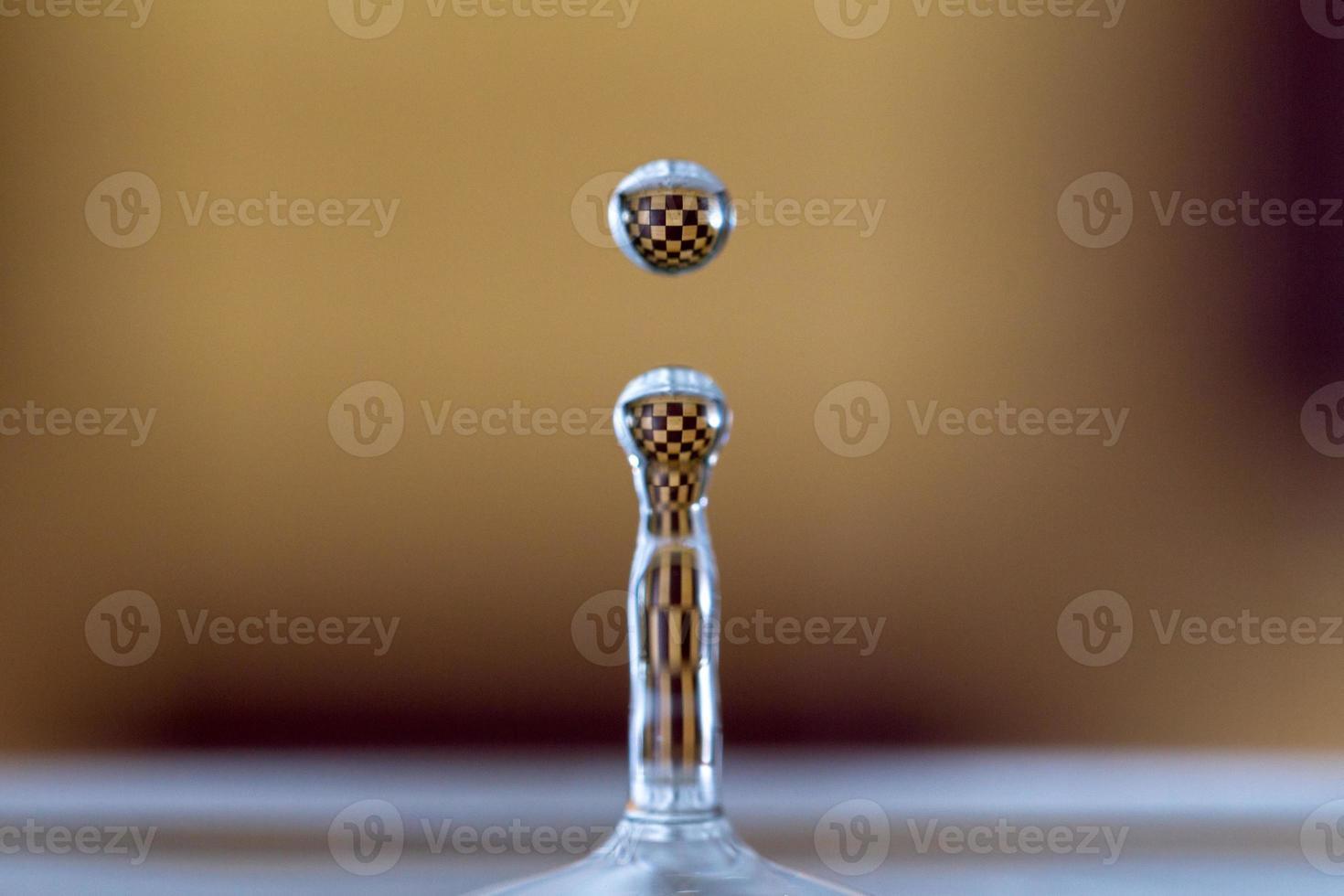 gocciolina di scacchi foto