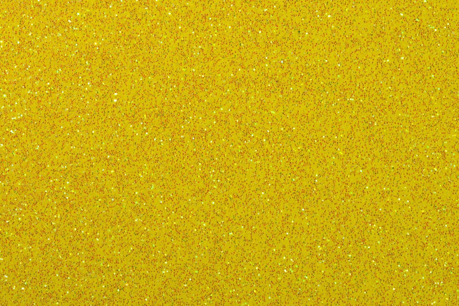sfondo di carta glitter giallo scuro foto
