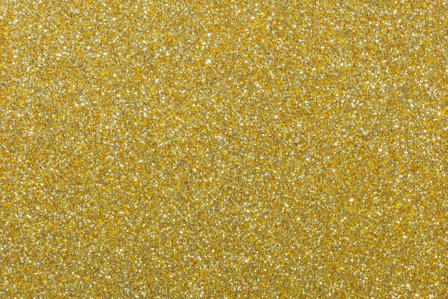 sfondo di carta glitter oro scuro foto